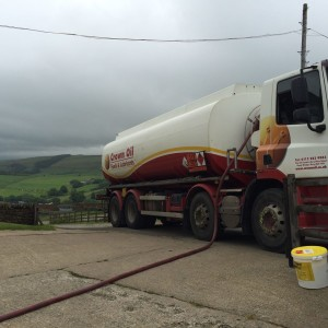 Side view of fuel tanker at the farm