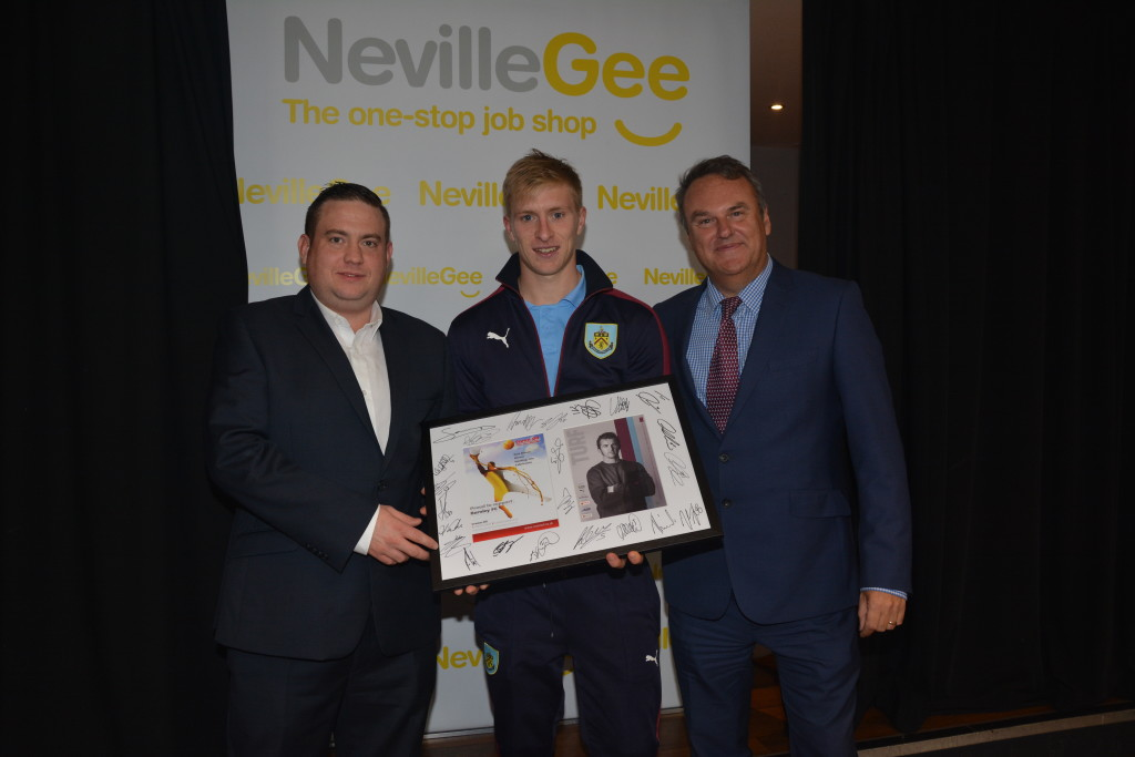 Ben Mee presenting the signed matchday programme to Crown Oil